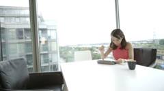 Asian Woman using digital tablet at home Stock Footage