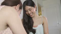 Asian Women applying make-up Stock Footage