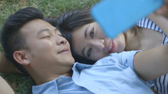 Young couple taking self-portrait Stock Footage