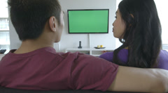 Young couple watching TV Stock Footage