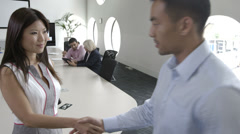 Asian Man and woman greeting Stock Footage