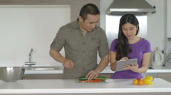 Young couple in kitchen - stock footage