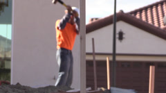 New Home Building boom, stake driver Stock Footage