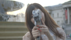 Asian tourist female filming on Trafalgar square, London Stock Footage