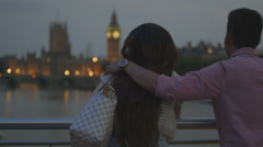 Romantic Asian Tourist couple standing on bridge Stock Footage