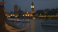 Exited Asian Tourist couple looking over river and Big Ben London - stock footage