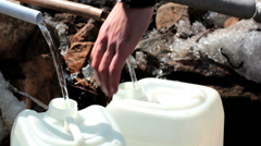 Well-water collecting in a canister Stock Footage