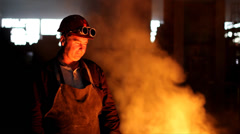 Worker with safety goggles in a foundry - stock footage