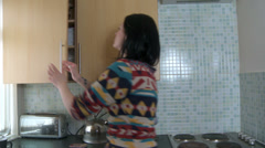 Stock Video Footage of Female preparing dinner in a panic