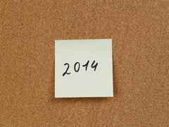 2014 reminder note on cork board Stock Photos