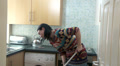Young woman doing housework, unhappy, angry, miserable HD Footage