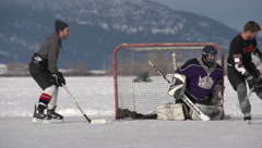 Sports, ice hockey on frozen lake, long shot Stock Footage