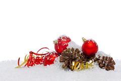 Christmas decorations on snow isolated background. Stock Photos