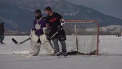 sports, ice hockey on frozen lake, true 240fps slow motion save long shot - stock footage