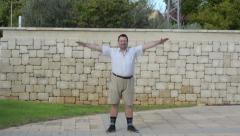 Fat man wants lean down Stock Footage