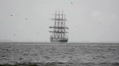 Big sailing ship Sedov is moving away Stock Footage