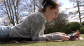 Pretty woman reading a magazine in the park Footage