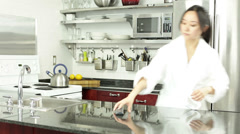 Asian girl in her kitchen Stock Footage