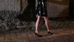 girl walking through the city at night  2 - stock footage