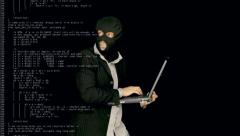 Masked criminal cybercrime source code Stock Footage