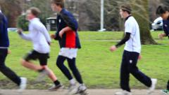 School boys out for a morning run Stock Footage