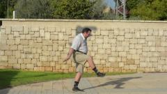 Man wants to lose weight by jumping rope Stock Footage