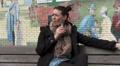 Woman sitting alone smoking HD Footage