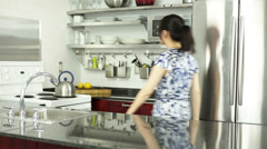 Asian girl in her kitchen - stock footage