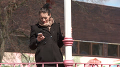 Woman outside waiting alone, expectant Stock Footage