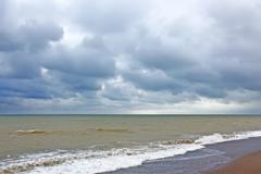 storm clouds over the sea surface - stock photo
