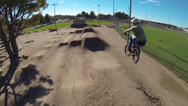 Stock Video Footage of Extreme Aerial Follow Cam of BMXer Jumping Trails