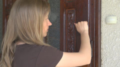 Blonde woman hand knock ring bell door girl house home enter arrive blonde - stock footage