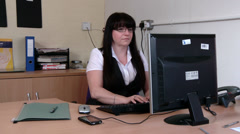 Woman at work getting stressed on computer Stock Footage