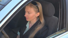 Businesswoman wait in traffic stop woman girl lady car driver blonde female suit Stock Footage