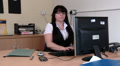 Female receives phone call whilst at work HD Footage