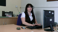 Woman at work gossips on her mobile Stock Footage