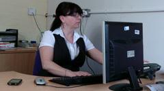 Woman at work mutitasking Stock Footage