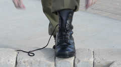 Soldier lacing boots Stock Footage