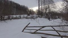 Girl woman poor sleigh snow mountain trip excursion lady sled ride hard Stock Footage