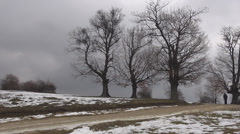 Woman walk winter commuter rural peaceful climb snow road village nature cloudy  Stock Footage
