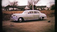 Family arrives in cars at reunion at grandmas, 455 vintage film home movie Stock Footage