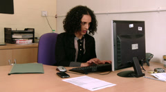 Woman doing day to day mundane office work Stock Footage