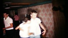451 - teenagers dance at birthday party in basement - vintage film home movie - stock footage
