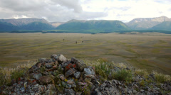 Stone mound against steppe and mountains - stock footage