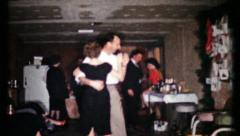 450 - adults dance & drink at basement party - vintage film home movie Stock Footage