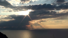 Moving clouds over the sea at sunset - stock footage