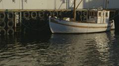 Fishingboat in harbor Stock Footage