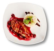 Delicious beef with cherry sauce. file includes clipping path for easy backgr Stock Photos