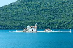 artificial island with a church on it (perast, montenegro, kotors bay) - stock photo