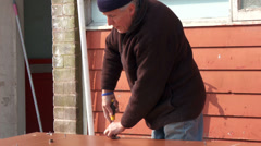 Carpenter using screw driver - stock footage